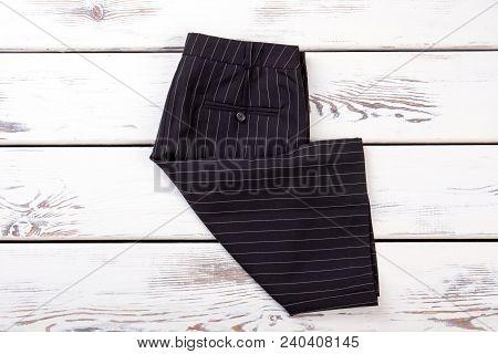 New Female Skirt Folded On Wooden Background. Fashionable Formal Skirt For Ladies. Female Basic Outf