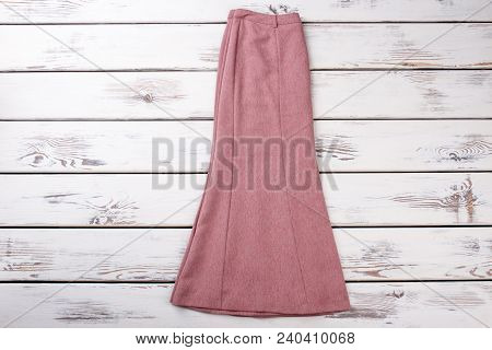 Female Colorful Skirt, Top View. Female Old-fashioned Pink Skirt On White Wooden Background. Boutiqu
