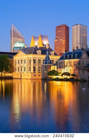 Mauritshuis Reflecting In Pond At Night, Netherlands