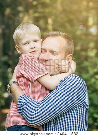 Father And Son Hugging And Smiling In The Garden. Masculinity Concept. Blondy People. Family.