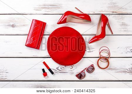 Collage Of Female Red Fashion Accessories. Stylized Flat Lay Of Ladies Red Beret, Heels, Purse And A