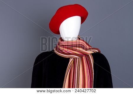 Mannequin In Female Autumn Outfit. Women Red Beret, Black Coat And Striped Scarf. Ladies Classic Clo