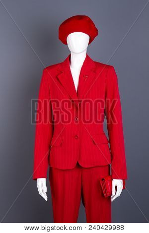 Female Mannequin In Red Elegant Garment. Mannequin With Red Beret, Jacket, Trousers And Wallet For L