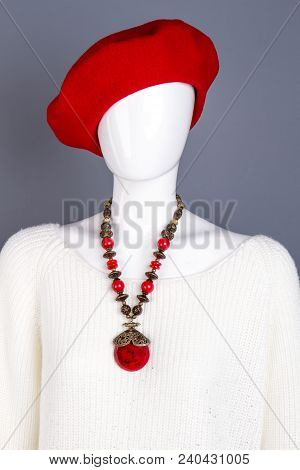 Mannequin With Red Beret And White Sweater. Female Red French Bere And Necklace. Women White Fashion