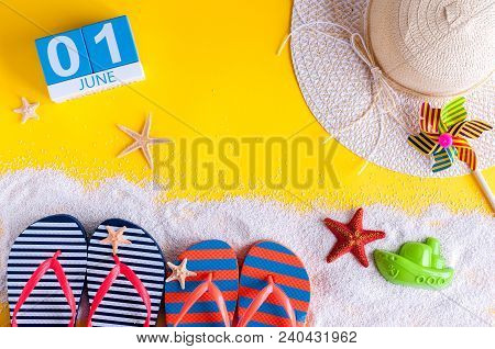 June 1st. Image Of June 1 Calendar On Yellow Sandy Background With Summer Beach, Traveler Outfit And