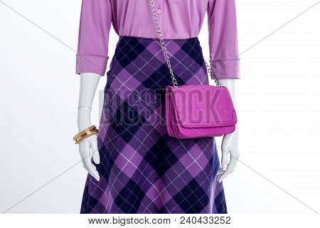 Close Up Women Fashionable Skirt And Accessories. Female Mannequin With Blouse, Patterned Skirt And