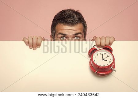 End Of Working Day Or Perfect Morning. Guy Hiding Face Behind White Paper. Man With Red Clock On Pin