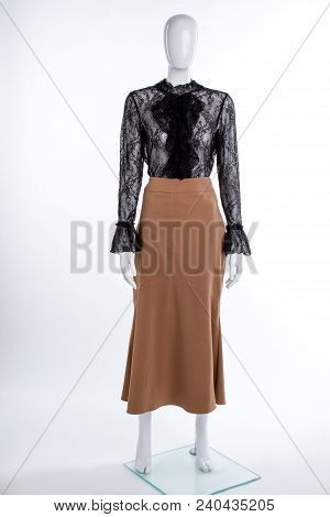 Black Blouse And Brown Skirt. Female Mannequin Dressed In Black Lace Blouse And Long Skirt. Women El
