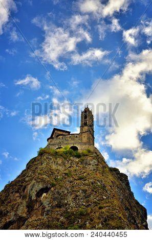 Saint-Michel d'Aiguilhe is a chapel in Aiguilhe, near Le Puy-en-Velay, France. It was built on a volcanic plug.The chapel is reached by steps carved into the rock. It was built t