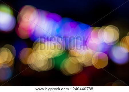 Blurry Night Light On Dark Background. Outdoor City Night Life Blurred View. Glowing Illumination Of
