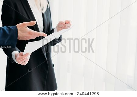 Communication And Interaction Between Business Coworkers. Data Exchange. Hand Pointing To Important