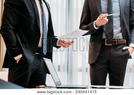Business Reports. Employee Giving Accounts To His Colleague. Work Feedback And Results. Coworker Com