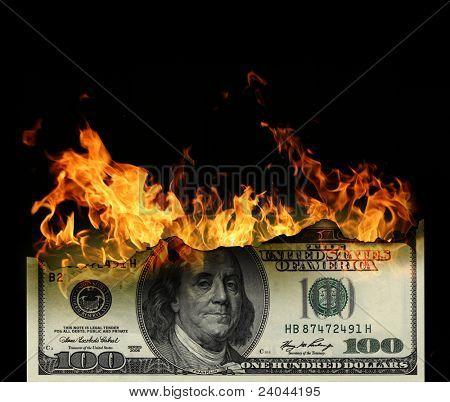 Burning dollars close up over black background