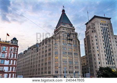 Shanghai, China - November 16, 2017 Peace Hotel Bund Buildings Evening Shanghai China  One Of The Mo