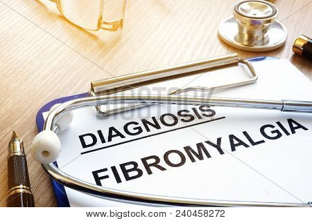Clipboard With Diagnosis Fibromyalgia And A Pen.