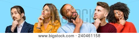 Group of mixed people, women and men thinking and looking up expressing doubt and wonder