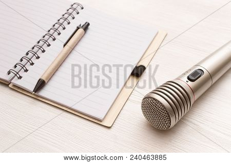 Audio Recording Studio Desk Table. Karaoke Mock Up. Microphone And Blank Page Notepad With Copy Spac