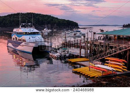 BAR HARBOUR - JULY 11: Beautiful Frenchman Bay sunset with docking boats in Bar Harbor, Maine on July, 11, 2013.