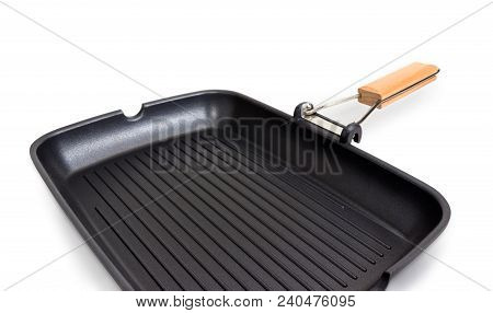 Fragment Of Grill Pan Rectangular Shape With Wooden Handle, Non-stick Coating And A Series Of Parall