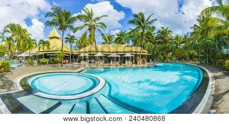 Grand Baie, Mauritius - February 18, 2018: Luxury Resort With Swim Pool At Grand Baie Village On Mau