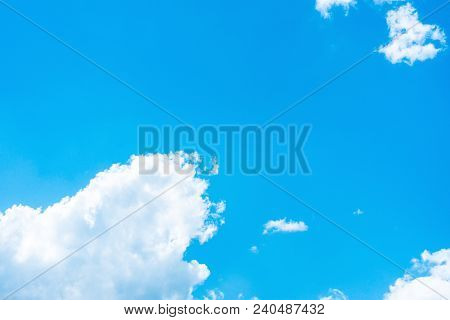 Clear Blue Sky With Big And Small Fluffy Transparent White Clouds In The Corner. Purity Heaven Medit