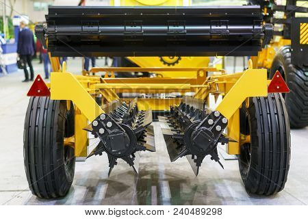 Agricultural Machinery In Agricultural Fair. New Agricultural Machinery At The Exhibition. Plow Mode