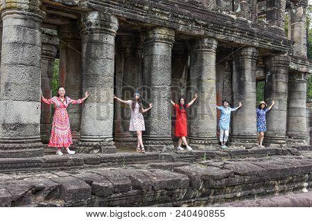 Women Posing At Ancient Preah Khan Temple In Angkor, Cambodia