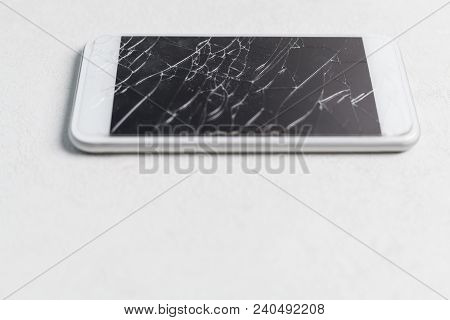 Modern Mobile Smartphone With Broken Screen On White Background Close Up. Need Screen Repair