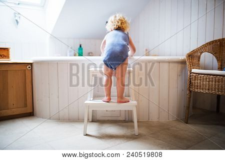 Little Toddler Boy Getting Into A Bathtub. Domestic Accident. Dangerous Situation In The Bathroom. R