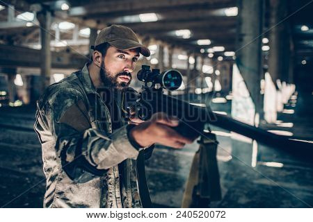 Confident Professional Is Keeping Silence. He Is Looking Right And Holding His Rifle With Both Hands
