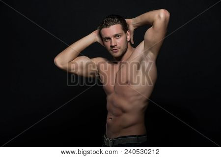 Man With Nude Muscular Torso Put Hands Behind Head Posing. Macho With Muscular Chest Looks Attractiv