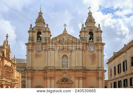 St Paul and Peter cathedral in Mdina, Malta. Catholic church under cloudy sky background. Ideal destination for pray and tourism.
