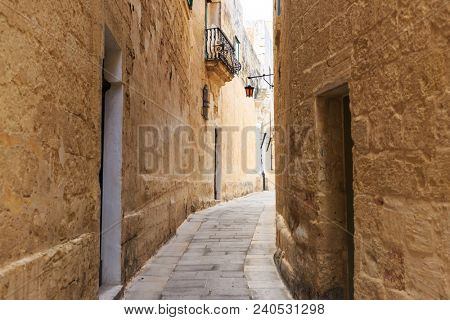 Mdina the traditional old town with cobblestone narrow streets, lanterns, peeled buildings, in Malta. Perfect destination for vacation and tourism.