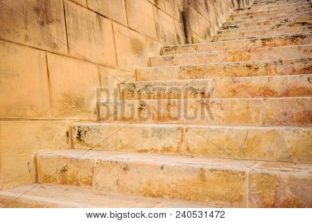 Stone wall and stairs in Valletta, Malta. Empty staircase for background. Close up view.