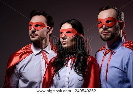 Super Businesspeople In Masks And Capes Looking Away Isolated On Grey