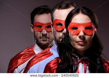 Super Businesspeople In Masks And Capes Standing In Line Isolated On Grey