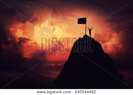 Self Overcome Concept As A Businessman Lift His Hands Up On The Top Of Al Mountain Reaching The Fini