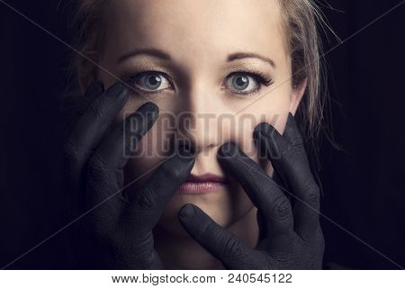 Frightened Blonde Woman Grabbed By Black Hands On Her Face