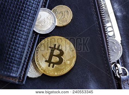 Bitcoin And Foreign Currency Coins On A Leather Wallet Background.  Virtual Money And Cryptocurrency