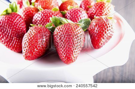 Strawberries Over White Stand, Close Up, Hoizontal Image