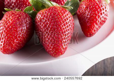 Strawberries Over White Stand, Close Up, Horizontal Image