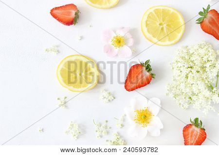 Styled Stock Photo. Summer Fruit Composition. Closeup Of Sliced Lemons, Elderflowers, Strawberries A