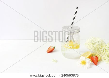 Styled Stock Photo. Still Life Composition With Homemade Elderflowers Lemonade In Glass Drinking Jar