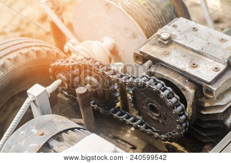electric winch or cultivator for of agricultural work, farming, cultivation, agro-industry, the chain mechanism and gear close-up.