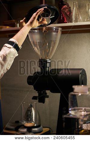 Barista Weighs Coffee On Scales Before Preparing Espresso. Professional Barista Equipment Prepare Fo