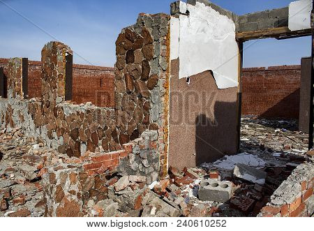 Destroyed building. Abandoned building. Destroyed brick building. Grunge building. Architectural background. Grunge style. Grunge background. Firebrick. Grunge brick. Grunge architecture.