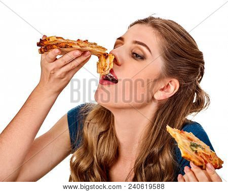 Woman eating pizza. Student consume fast food on table. Cook teaches to cook and shares recipes. Girl eagerly eats junk alone without embarrassment. She can not refuse harmful food.