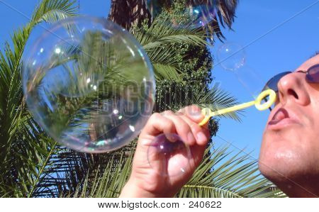 Young Man Blows Bubbles