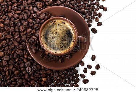 Cup Of Freshly Brewed Coffee On Pile Of Coffee Beans Isolated On White Background
