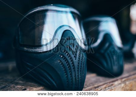 Paintball mask with glasses closeup, nobody